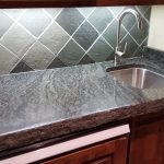 Granite bar counter with undermount sink and hand chiseled edge