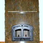 Full granite slab fireplace with matching granite shelf and hearth