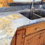 Blue Bahia granite counters with hand chiseled granite window sill