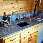 lue Bahia granite bar counter with granite backsplash and undermount sink