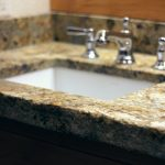 granite bathroom counter with hand chiseled edge