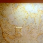 Custom painted outlet covers to match/blend with the granite backsplash