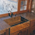 Custom granite sink and counters with hand carved rope detail