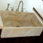 Custom granite farmhouse sink to match granite counters